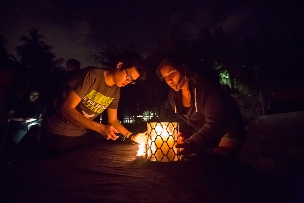 Candlelight vigil laments tragedies in Paris, Beirut