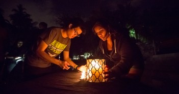 Sophomore David Lin and junior Aalekhya Reddam light the candles for Wednesday evening's candlelight vigil on the Rock. Nick Gangemi // Editor in Chief