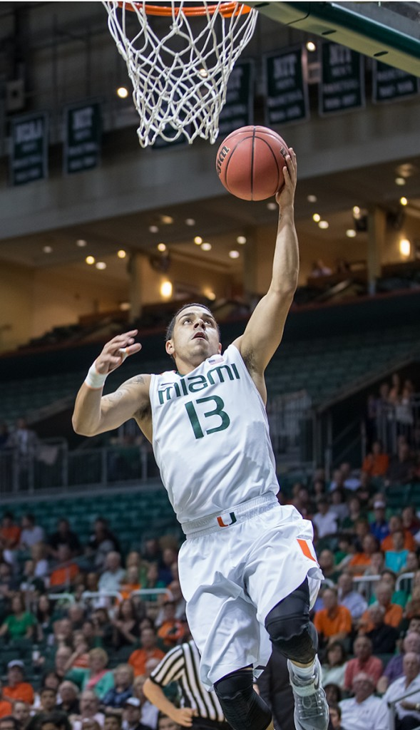 Redshirt senior Angel Rodriguez (No. 13) goes up for a layup in the first round of the 2014-2015 NIT. File Photo // The Miami Hurricane