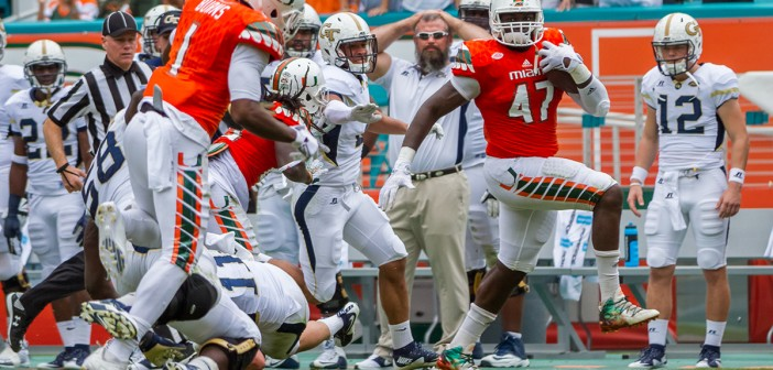 Miami Hurricanes squash Yellow Jackets 38-21