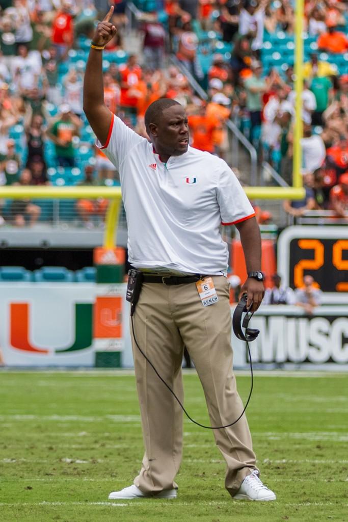 Interim Head Coach Larry Scott celebrates a touchdown during Saturday's game. Nick Gangemi // Editor-in-Chief