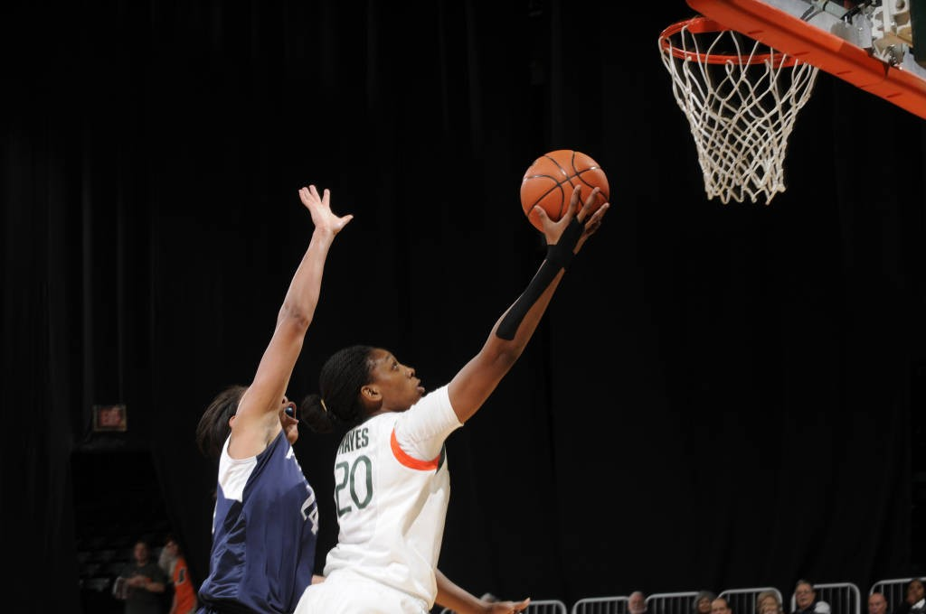 Redshirt junior Keyona Hayes (20) attempts a finger roll in a UM home game. Photo Courtesy HurricaneSports.com