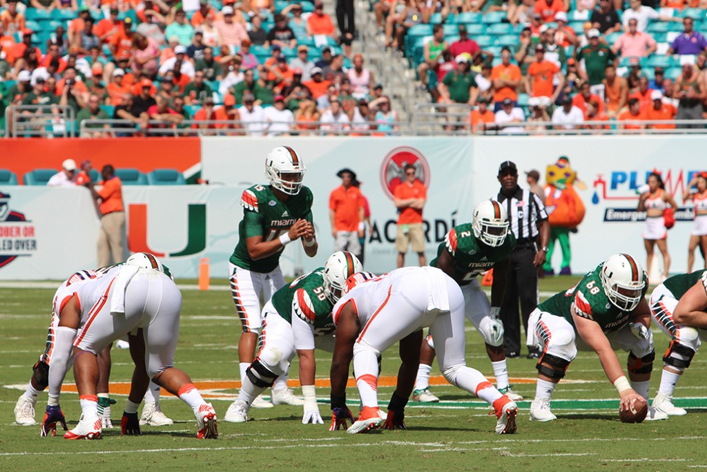 Sophomore quarterback Brad Kaaya (15) lines up behind sophomore center Nick Linder (68) during the first half of the game against Clemson on Oct. 24. The offensive line continued to struggle in protecting Kaaya during Saturday's 59-21 loss to North Carolina in Chapel Hill. Joshua Gruber // Contributing Photographer