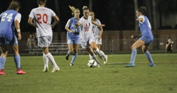 Senior and team co-captain Natalie Moik (10) drives past North Carolina defenders during Saturday's game at Cobb Stadium. The Canes were defeated 2-0 during the final match of their season. Kawan Amelung // Staff Photographer
