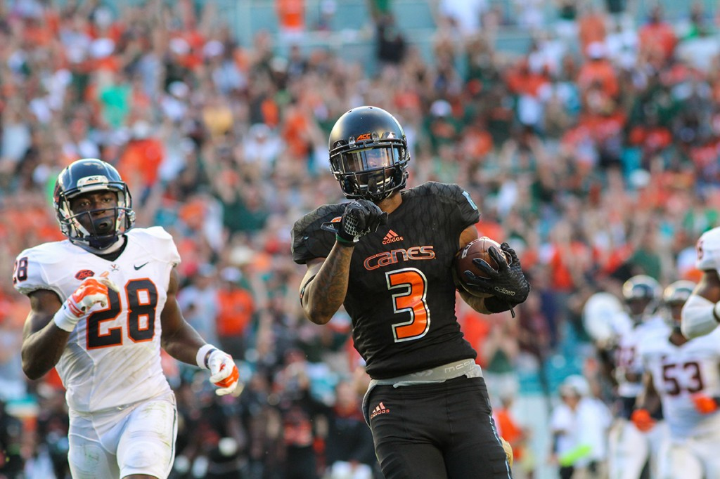 Junior receiver Stacy Coley (3) runs toward the endzone to score a touchdown during Saturday's 27-21 victory over Virginia. Kawan Amelung // Staff Photographer