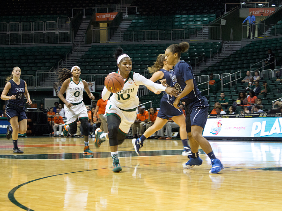 Michelle Woods (10) drives past a Nova Southeastern University defender Wednesday afternoon at the Bank United Center. The Canes won 83-53. Giancarlo Falconi // Assistant Photo Editor
