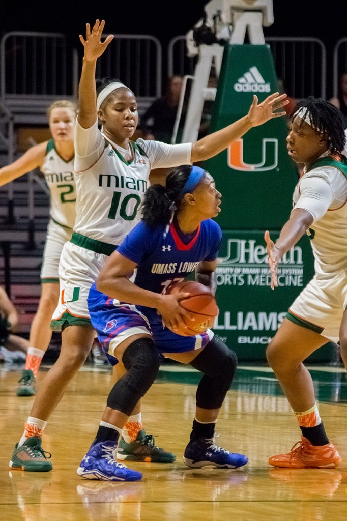 Red shirt senior guard Michelle Woods (10) defends a River Hawk player during Sunday's game against UMass Lowell in the BankUnited Center. The Canes won 84-53. Shreya Chidarala // Assistant Photo Editor