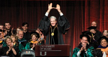 "The sixth President of the University of Miami Julio Frenk throws up the ""U"" to conclude his speech at the inauguration ceremony in the BankUnited Center Friday afternoon. Victoria McKaba // Assistant Photo Editor"
