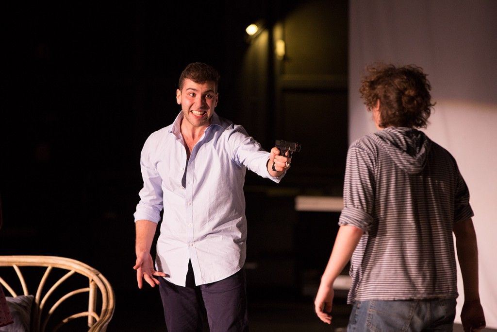 "Jim, played by Bennett Leeds, points a gun at Aaron, played by Jacob Garwood, during in ""The Killer Inside,"" the second of six plays performed Saturday evening at the Jerry Herman Ring Theatre for The 24 Hour Plays event. Nick Gangemi // Editor-in-Chief"