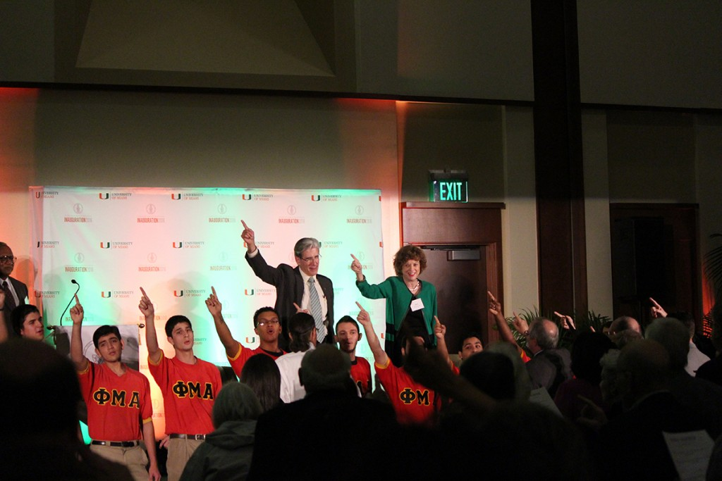 President Frenk and Arva Moore Parks sing the alma mater with Firsts at UM attendees. Hallee Meltzer // Photo Editor