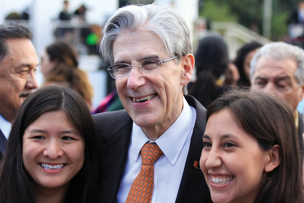 Newly inaugurated President Julio Frenk poses with seniors Megan Lee (left) and Miranda Goot (right) during the community reception on the Lakeside Patio Friday afternoon, which followed his inauguration ceremony. Victoria McKaba // Assistant Photo Editor
