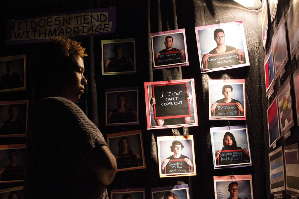 Junior Kayla Derby walks through the Tunnel of Oppression, an exhibit sponsored by the Butler Center that highlights the different forms of oppression experienced around the world. Giancalo Falconi // Staff Photographer