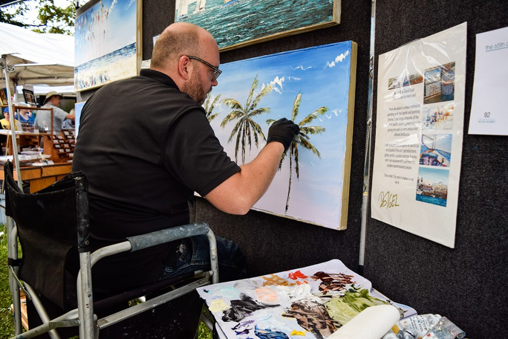 Artist David Sigel showcases his talent for painting natural Florida landscapes at the 65th annual Beaux Arts Festival on Saturday. The Festival of Art brings in artists from around the world in support of raising funds for the Lowe Art Museum. Evelyn Choi // Staff Photographer