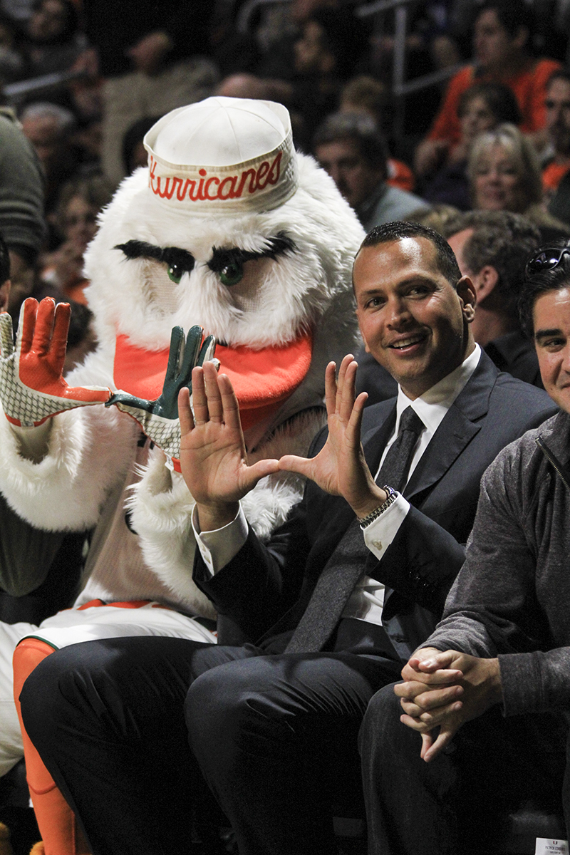 "This week's Photo of the Week comes from assistant photo editor Victoria McKaba from Monday night's men's basketball game against Duke. Yankee's player and Cane alumnus Alex Rodriguez throws up the ""U"" with Sebastian the Ibis in support of the team."