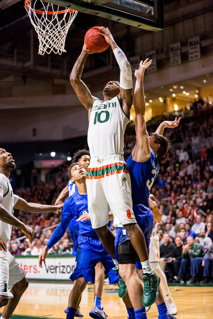 Redshirt senior Sheldon McClellan jumps for a layup during Monday's night game against Duke at the BankUnited Center. The Hurricanes defeated the Blue Devils 80-69. Nick Gangemi // Editor-in-Chief