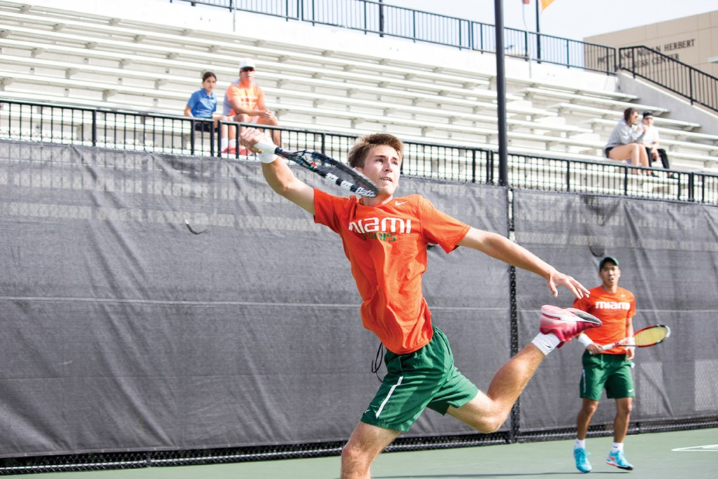Sophomore Piotr Lomacki competes in last season's match against Liberty. Lomacki is currently ranked No. 23 in the country for men's tennis and is pursuing a professional career. Giancarlo Falconi // Staff Photographer