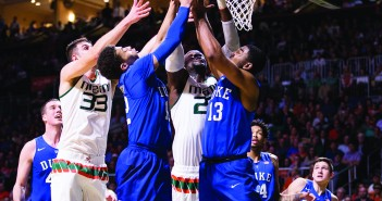 Senior center Tonye Jekiri and senior forward Ivan Cruz Uceda challenge two Duke players for a rebound during Monday night's game at the BankUnited Center. The Hurricanes won the game 80-69, improving their record to 16-3. Nick Gangemi // Editor-in-Chief