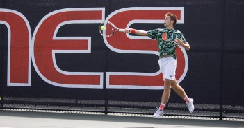 Sophomore Piotr Lomacki takes a forehand shot during his singles match Saturday afternoon at the Neil Schiff Tennis Center. The Hurricanes beat Troy University 4-3. Giancarlo Falconi // Staff Photographer
