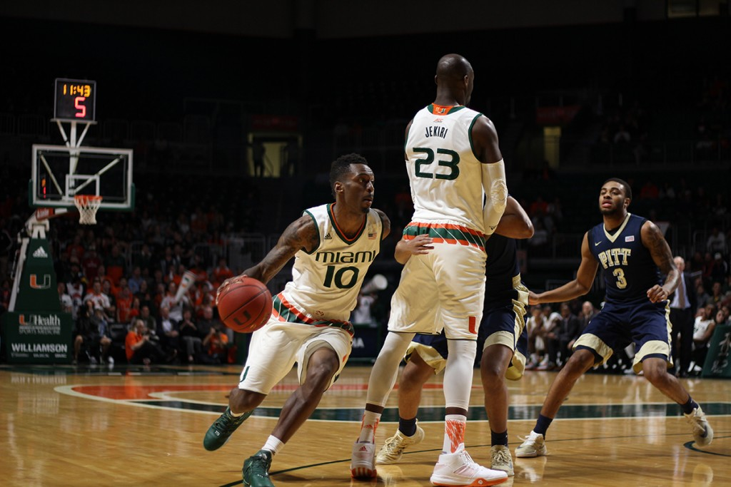 Redshirt senior guard Sheldon McClellan (10) dribbles around players in order to charge to the net during the Hurricanes 65-63 win over Pittsburgh Tuesday night at the BankUnited Center. Kawan Amelung // Staff Photographer