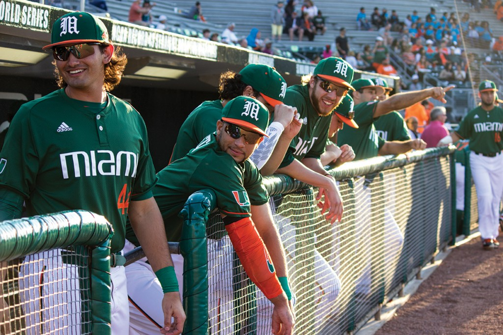 The men's baseball team hang outs in the dugout before the annual Alumni game at Mark Light Field at Alex Rodriguez Stadium Saturday afternoon. The team is preparing for their opening series against Rutgers this weekend. Giancarlo Falconi // Staff Photographer