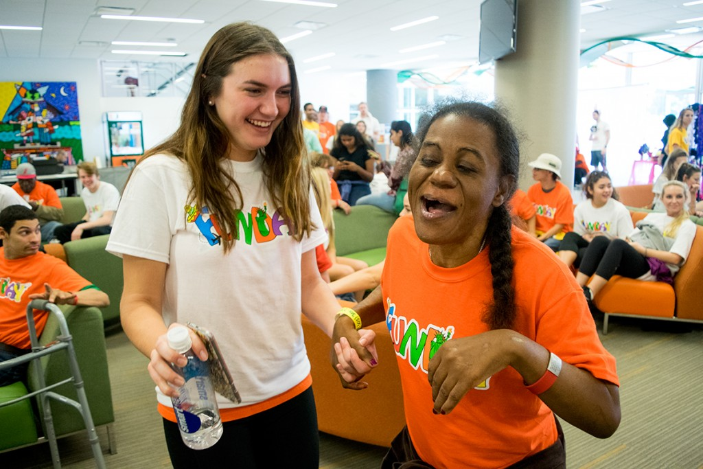 Freshman Taylor McCloskey and her FunDay partner Susy share a laugh in the University Center Saturday afternoon. FunDay is the longest standing service day at the University of Miami and brings over 300 special citizens from the surrounding area on campus to enjoy a day of fun and games. Evelyn Choi // Staff Photographer