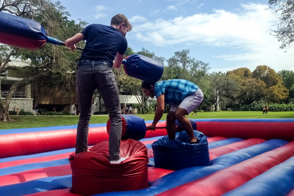 Freshmen Sean McDuffie and Landon Mediavilla joust outside the engineering school Tuesday afternoon as part of Engineering Week. Giancarlo Falconi // Staff Photographer