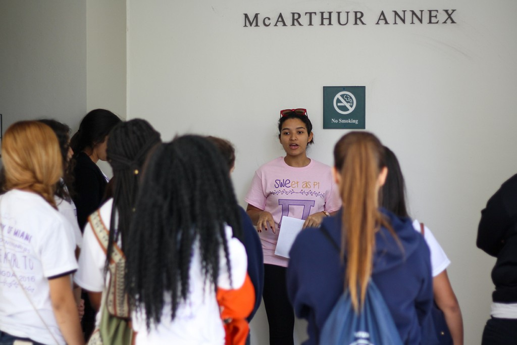 Freshman Bruna da Silva leads a group of high school scholars on a tour of the College of Engineering during the Society of Women Engineers' Introduce a Girl to Engineering Day Thursday morning. Kawan Amelung // Staff Photographer