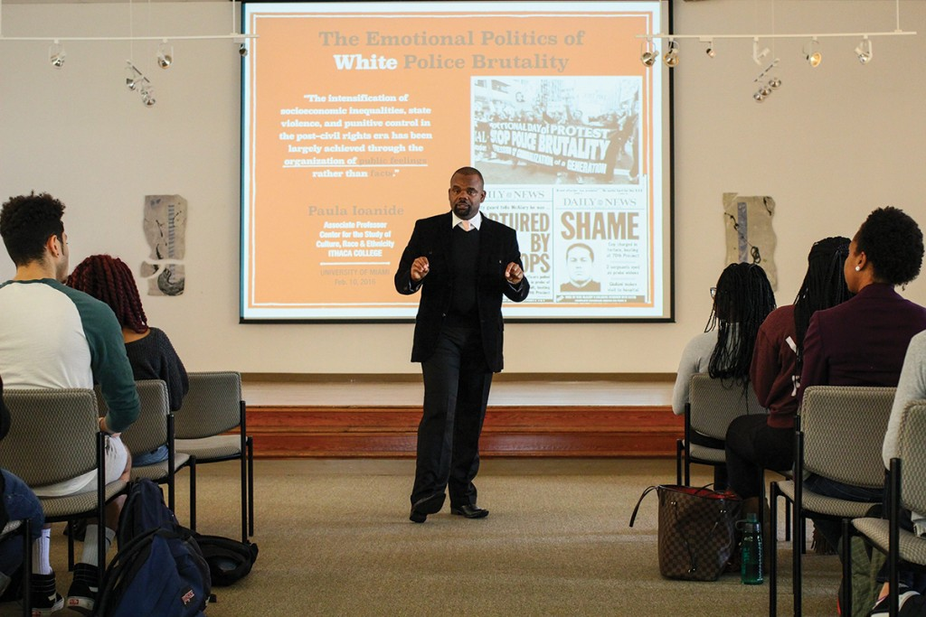 Dr. Rashawn Ray, of the University of Maryland, College Park, lectures during the Know Justice Know Peace 2 event in the CAS Gallery Wednesday afternoon. Erum Kidwai // Staff Photographer