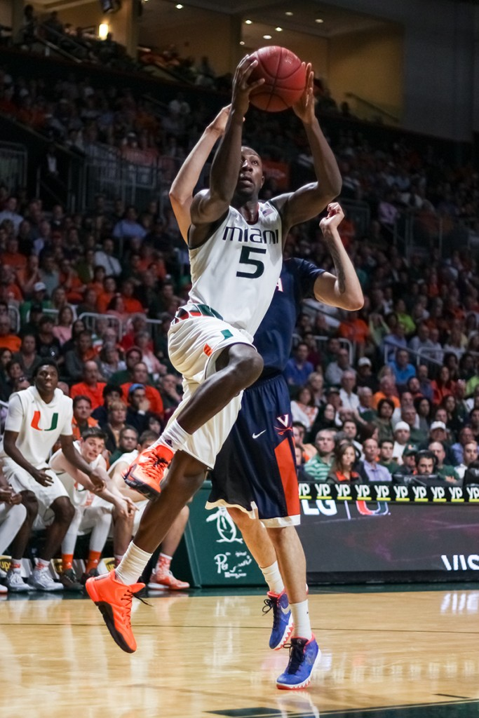 Junior guard Davon Reed jumps up for a shot during Monday night's game against Virginia at the BankUnited Center. The Canes defeated the Cavaliers 64-61.