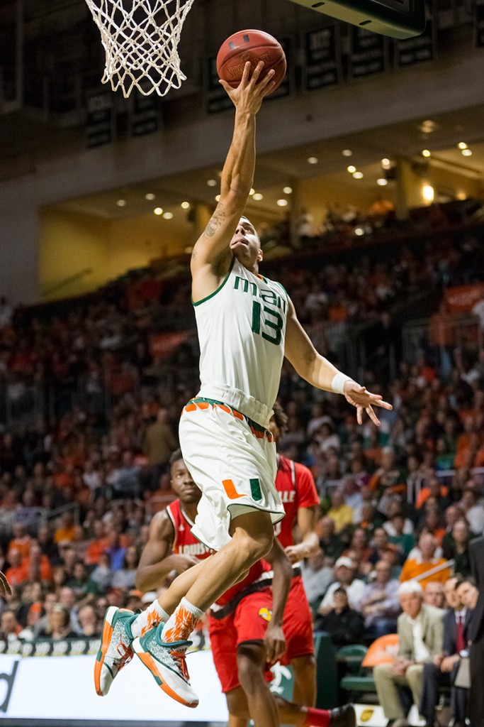 Redshirt senior guard Angel Rodriguez jumps for an uncontested layup during Saturday afternoon's men's basketball game against Louisville. The Hurricanes defeated the Cardinals 73-65. Nick Gangemi // Editor-in-Chief