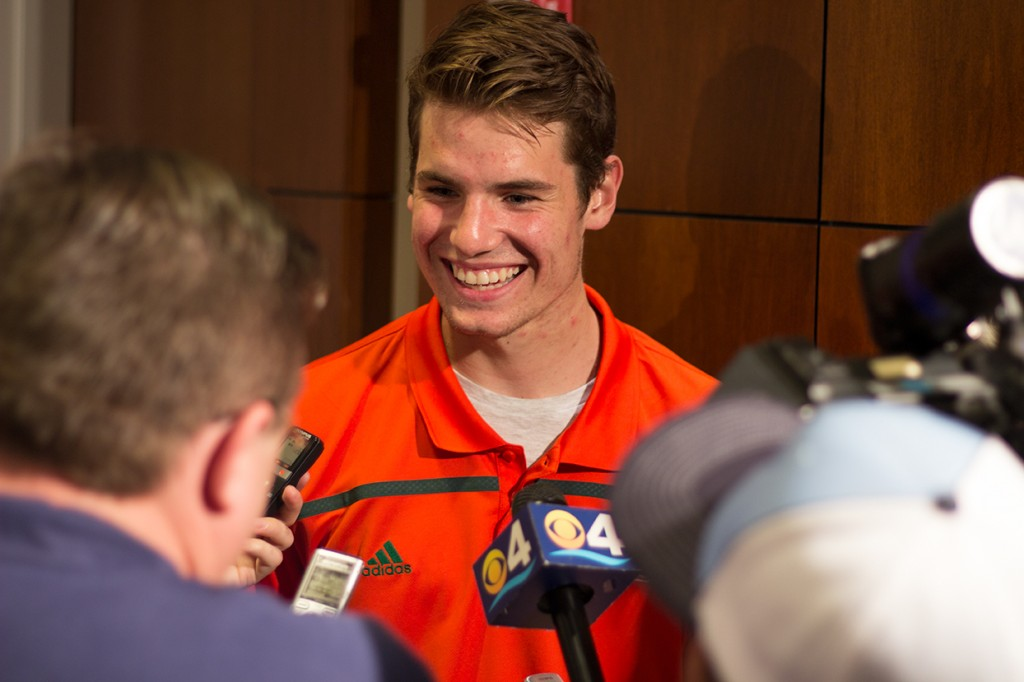 Freshman Jack Allison talks to reporters at the National Signing Day event at the Schwartz Center Wednesday afternoon. Allison is a Palmetto native and plays quarterback. Kawan Amelung // Staff Photographe