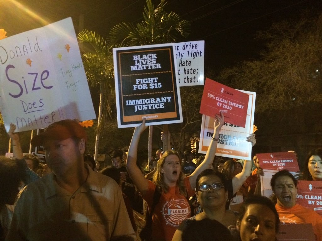 Protesters gather outside Republican primary debate at University of Miami