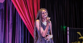 "Junior Chinonyelum ""Chi-Chi"" Maduka sings during the Miss University of Miami pageant Tuesday night in the Shalala Student Center. Maduka was crowned Miss UM 2016. Giancarlo Falconi // Staff Photographer"