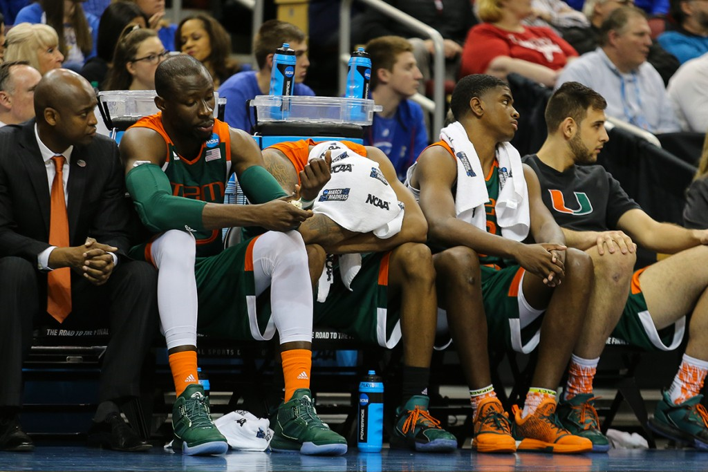 Miami Hurricanes men's basketball players look on as Villanova defeats the Canes 92-69 during the Sweet 16 game in Louisville Thursday evening. Michael Reaves // Contributing Photographer