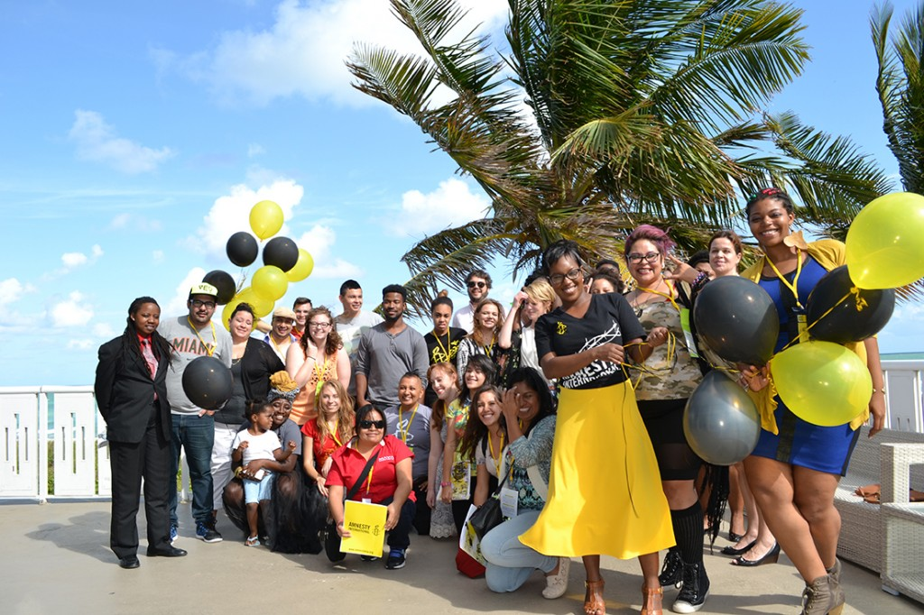 Amnesty International gathers for a photo. They will be hosting their Human Rights conference this weekend at the DoubleTree in Miami. Photo courtesy Amnesty International
