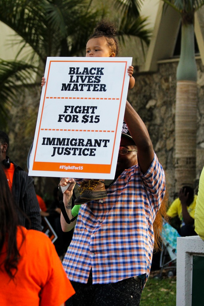 Protesters gather outside the University of Miami gates to advocate for higher minimum wage Thursday afternoon. Victoria McKaba // Assistant Photo Editor