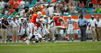 Defensive lineman Ufomba Kamalu (47) runs the ball down Georgia Tech's sideline after picking up a fumble by Georgia Tech at Sun Life Stadium during the final home game of the 2015 regular season. Kamalu and defensive back Artie Burns (1) participated in Miami's Pro Day Wednesday afternoon at the Greentree Practice Fields. Nick Gangemi // Editor-in-Chief