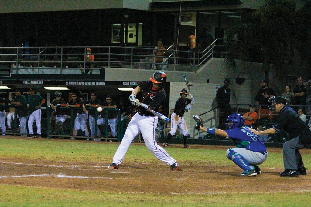 Junior catcher Zack Collins (0) hits a home-run to give the Canes the go-ahead run during baseball's 6-2 win over FGCU Wednesday night at Alex Rodriguez Park at Mark Light Field. Victoria McKaba // Assistant Photo Editor