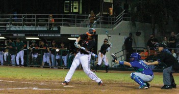 Junior catcher Zack Collins (0) hits a home-run to give the Canes the go-ahead run during men's baseball's 6-2 win over FGCU Wednesday night at Alex Rodriguez Park at Mark Light Field. Victoria McKaba // Assistant Photo Editor