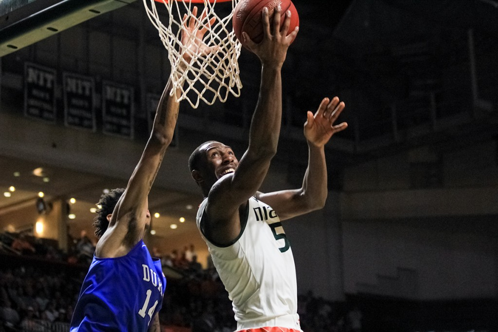 Junior guard Davon Reed (5) goes for a layup during the Canes 80-69 win against Duke at home in January. Victoria McKaba // Assistant Photo Editor