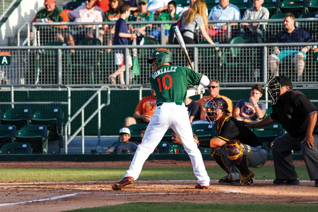 Freshman third baseman Romy Gonzalez (10) hits during the Hurricanes' 5-4 win over Bethune-Cookman Wednesday night at Alex Rodriguez Park at Mark Light Field. Gonzalez hit a two-run single in the sixth inning to put the Canes up 5-3. Victoria McKaba // Assistant Photo Editor