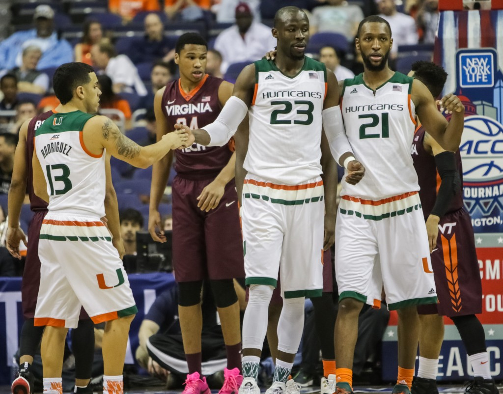 Tonye Jekiri (23) is surrounded by his teammates after drawing a foul in the first half against Virginia Tech, March 10, 2016. (Zack Wajsgras / Collegiate Times)