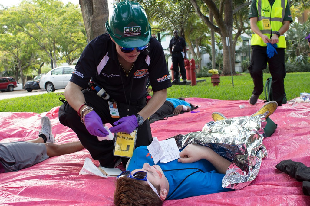 CERT Vice President of Training Harry Levine administers aid outside of the Memorial building during the CERT Disaster Readiness Exercise Sunday. Giancarlo Falconi // Staff Photographer
