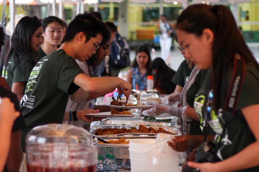 Students learn about different cultures and enjoy free food at the Middle Eastern night for the Council of International Students and Organizations' International Week at the Lakeside Patio Tuesday evening. Kawan Amelung // Staff Photographer