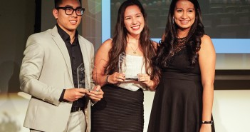 Juniors Quang Nguyen and Daniela Perez accept the People's Choice Award on behalf of their respective organizations, the Chinese Students Scholars Association and the Association of Commuter Students, at the SOAR Awards Wednesday evening in the Shalala Student Center. Hunter Crenian // Contributing Photographer