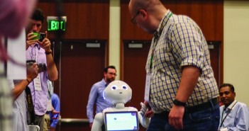 "Bill Lott of Aldebaran Robotics introduces ""Pepper"" Friday during the We Robot 2016 conference hosted by the UM School of Law. ""Pepper"" is the first humanoid robot able to recognize and adapt his behavior to the principal human emotions of those who interact with him. Kawan Amelung // Staff Photographer"