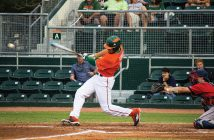 Junior outfielder Willie Abreu (13) finishes his swing at Alex Rodriguez Park at Mark Light Field Wednesday night. The Canes lost 4-3 against FAU. Giancarlo Falconi // Staff Photographer