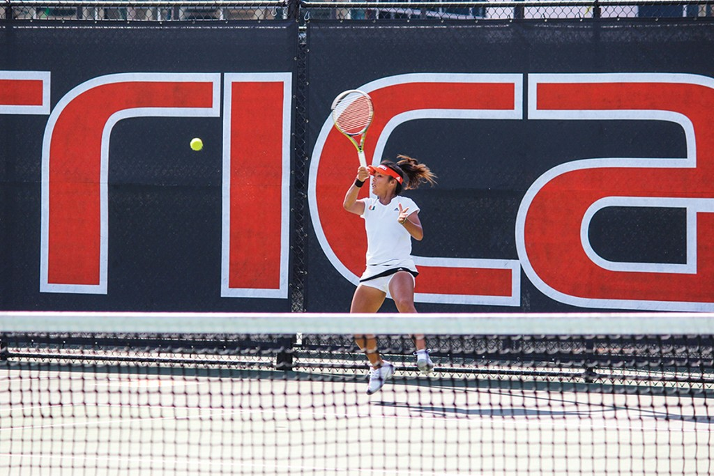 Sophomore Wendy Zhang hits a forehand shot during the Cane's 4-2 win over Ohio State in March. Zhang had her first career win over a top-25 opponent on Saturday against Clemson. Giancarlo Falconi // Staff Photographer