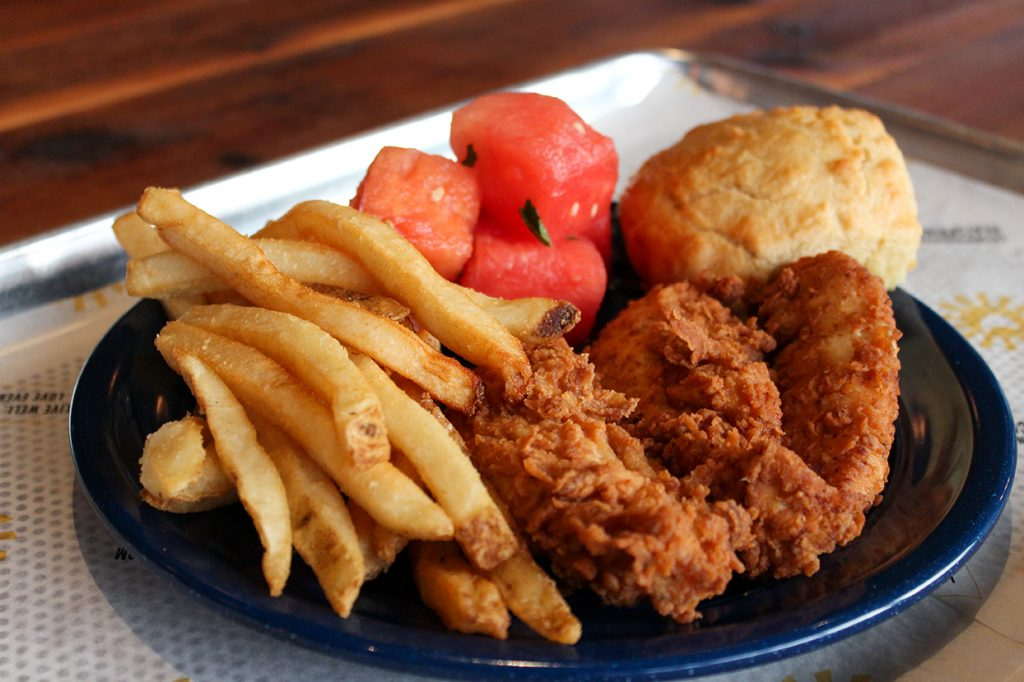 The Two Piece Jumbo Tenders Blue Plate from Spring Chicken comes with fried chicken, house fries, and minty watermelon. Hallee Meltzer // Photo Editor