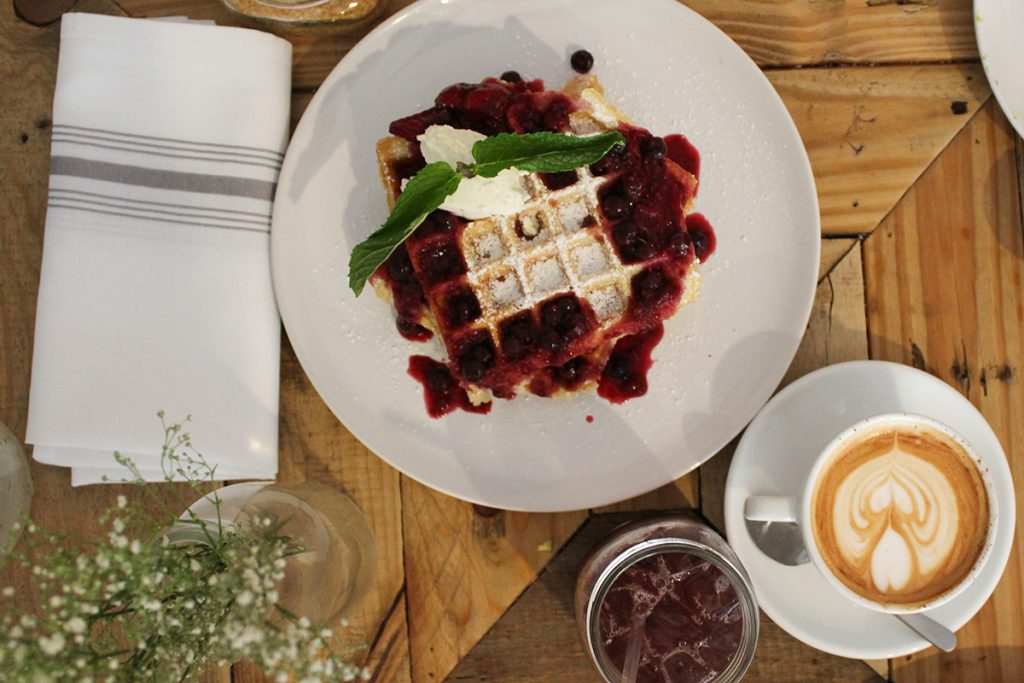 "Threefold Cafe's ""Waffle On…"" is topped with berry compote and vanilla bean marscapone. Jackie Yang // Opinion Editor"